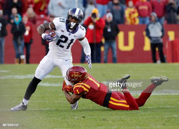 Running back Kyle Hicks of the TCU Horned Frogs is tackled by defensive back D'Andre Payne of the Iowa State Cyclones as he rushed for yards in the...