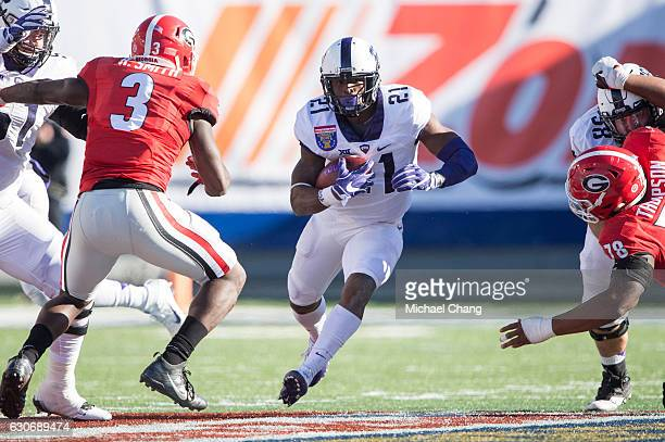 Running back Kyle Hicks of the TCU Horned Frogs looks to maneuver by linebacker Roquan Smith of the Georgia Bulldogs at Liberty Bowl Memorial Stadium...