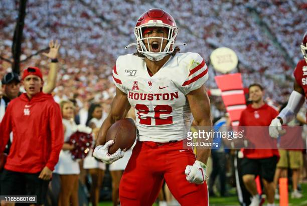 Running back Kyle Porter of the Houston Cougars celebrates a touchdown against the Oklahoma Sooners at Gaylord Family Oklahoma Memorial Stadium on...