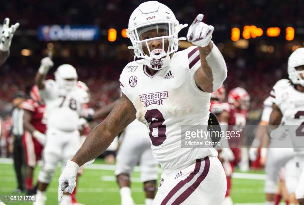 Running back Kylin Hill of the Mississippi State Bulldogs celebrates after scoring a touchdown during the third quarter of their game against the...