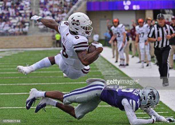 Running back Kylin Hill of the Mississippi State Bulldogs dives into the end zone for a touchdown during the first half over defensive back AJ Parker...