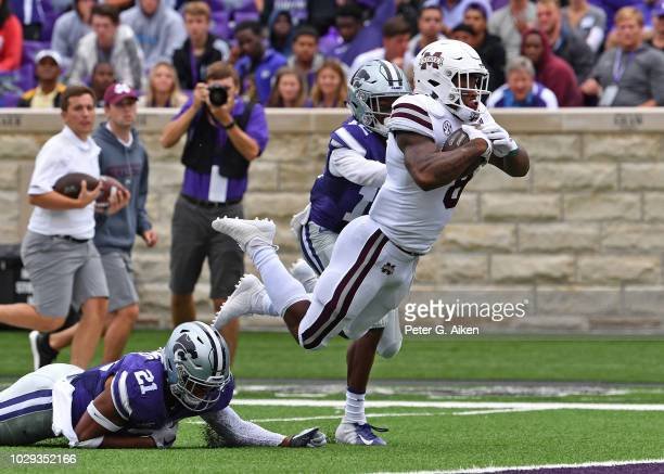 Running back Kylin Hill of the Mississippi State Bulldogs dives into the end zone for a touchdown during the first half against the Kansas State...