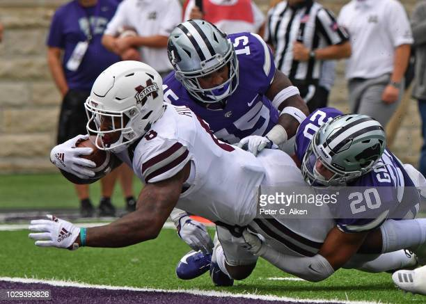 Running back Kylin Hill of the Mississippi State Bulldogs dives into the end zone for a touchdown against defensive back Denzel Goolsby and defensive...