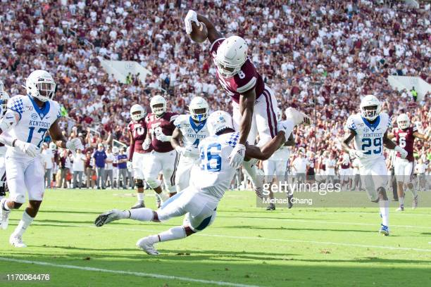 Running back Kylin Hill of the Mississippi State Bulldogs leaps for more yards while being hit by defensive back Brandin Echols of the Kentucky...