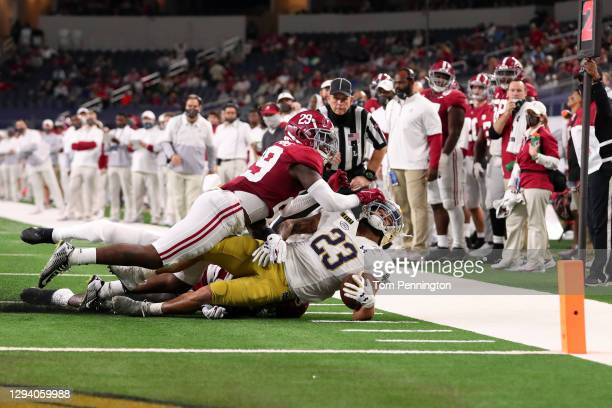 Running back Kyren Williams of the Notre Dame Fighting Irish is tackled by defensive back DeMarcco Hellams of the Alabama Crimson Tide during the...