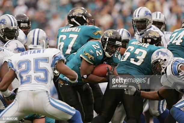 Running back LaBrandon Toefield of the Jacksonville Jaguars runs upfield towards linebacker Fernando Bryant of the Detroit Lions at Alltel Stadium on...