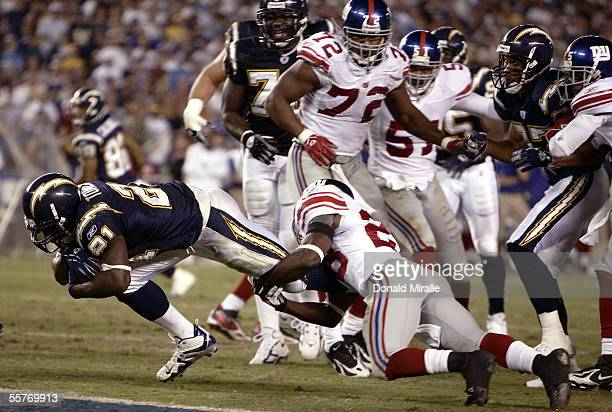 Running back LaDainian Tomlinson of the San Diego Chargers dives into the end zone for a touchdown against safety Gibril Wilson of the New York...