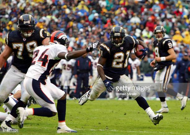 Running back LaDainian Tomlinson of the San Diego Chargers runs for a gain against cornerback Champ Bailey of the Denver Broncos during the Charger's...