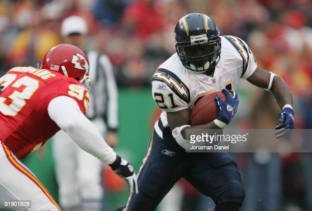 Running back LaDainian Tomlinson of the San Diego Chargers runs upfield against defensive tackle John Browning of the Kansas City Chiefs at Arrowhead...