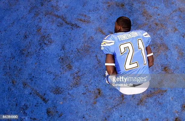 Running back LaDainian Tomlinson of the San Diego Chargers stretches on the field before the start against the Indianapolis Colts during the Chargers...