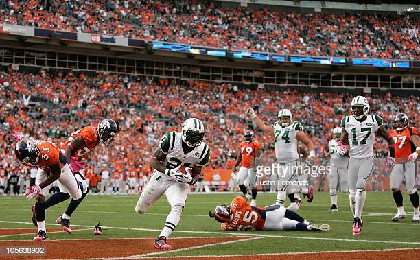 Running back LaDainian Tomlinson the New York Jets strides into the endzone for a touchdown against the Denver Broncos at INVESCO Field at Mile High...