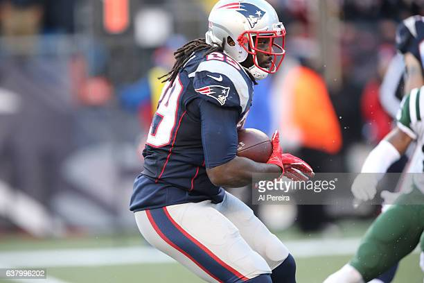 Running Back LaGarrette Blount of the New England Patriots has a short gain against the New York Jets at Gillette Stadium on December 24 2016 in...