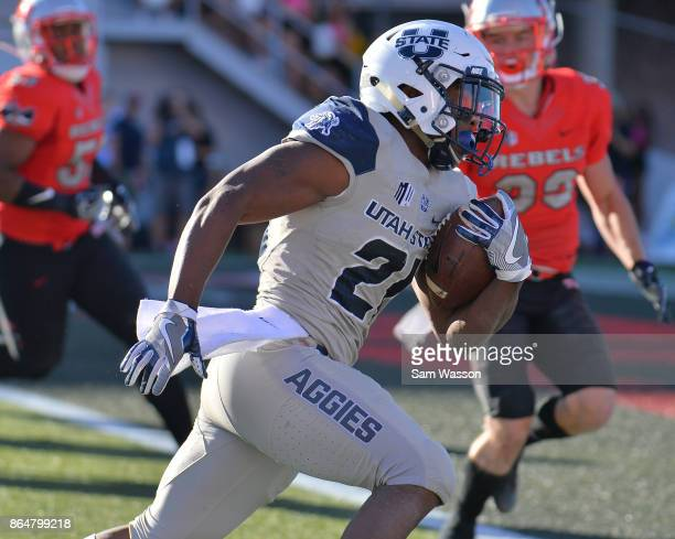 Running back LaJuan Hunt of the Utah State Aggies runs for a touchdown during their game against the UNLV Rebels at Sam Boyd Stadium on October 21...