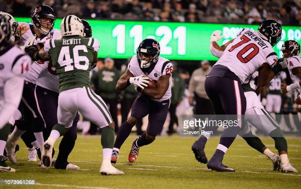 Running back Lamar Miller of the Houston Texans runs the ball against the New York Jets in the first quarter at MetLife Stadium on December 15, 2018...