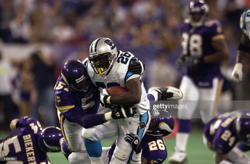 Running back Lamar Smith #26 of the Carolina Panthers carries the ball as he is tackled by defensive end Lance Johnstone #51of the Minnesota Vikings and teammate safety Ronnie Bradford #26 during the game on September 22, 2002 at the Hubert H. Humphrey Metrodome in Minneapolis, Minnesota. The Panthers defeated the Vikings 21-14.