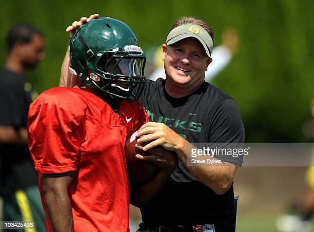 Running back LaMichael James and head coach Chip Kelly of the Oregon shares a laugh during the Ducks practice on August 17, 2010 in Eugene, Oregon.