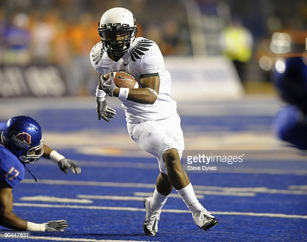 Running back LaMichael James of the Oregon Ducks avoids the tackle by safety Winston Venable of the Boise State Broncos in the third quarter of the...