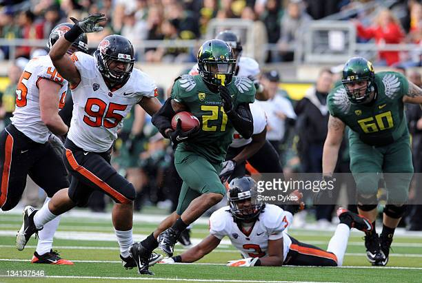 Running back LaMichael James of the Oregon Ducks breaks into the open for a good gain as defensive end Scott Crichton of the Oregon State Beavers...