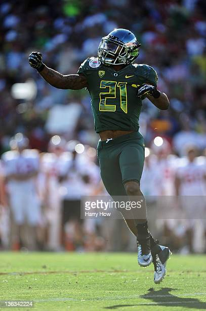 Running back LaMichael James of the Oregon Ducks celebrates his oneyard touchdown run in the first quarter against the Wisconsin Badgers at the 98th...