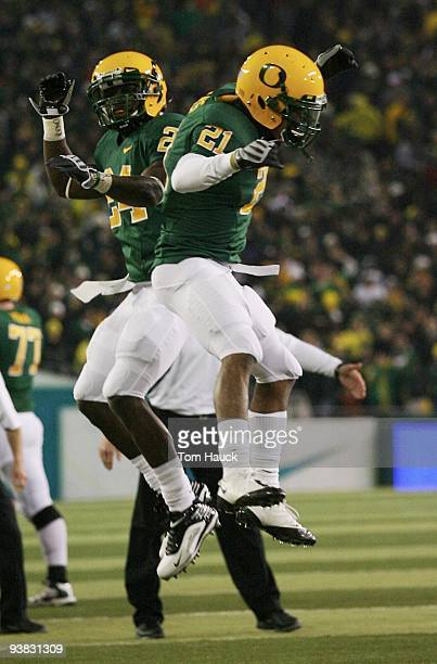 Running back LaMichael James of the Oregon Ducks celebrates with teammate Ryan McCants after scoring a touchdown against the Oregon State Beavers at...