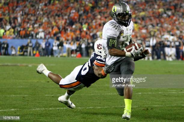 Running back LaMichael James of the Oregon Ducks scores a touchdown on a two-yard touchdown reception in front of Craig Stevens of the Auburn Tigers...