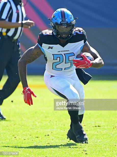Running back Lance Dunbar of the Dallas Renegades runs the ball after a complete pass in the first half of the XFL game against the Los Angeles...