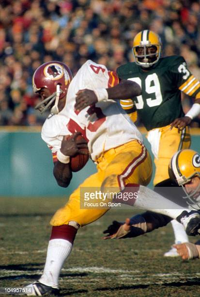 Running back Larry Brown of the Washington Redskins carries the ball against the Green Bay Packers during an NFL game November 31974 at Lambeau Field...