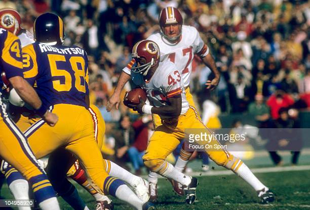 Running back Larry Brown of the Washington Redskins carries the ball against the Los Angeles Rams during an NFL game December 9 1974 at the Los...