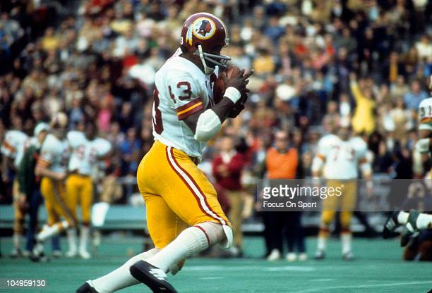 Running back Larry Brown of the Washington Redskins carries the ball during an NFL game circa 1973 Brown played for the Redskins from 196976