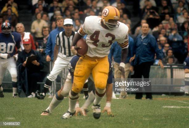 Running back Larry Brown of the Washington Redskins carries the ball against the New York Giants during an NFL game November 151970 at Yankee Stadium...