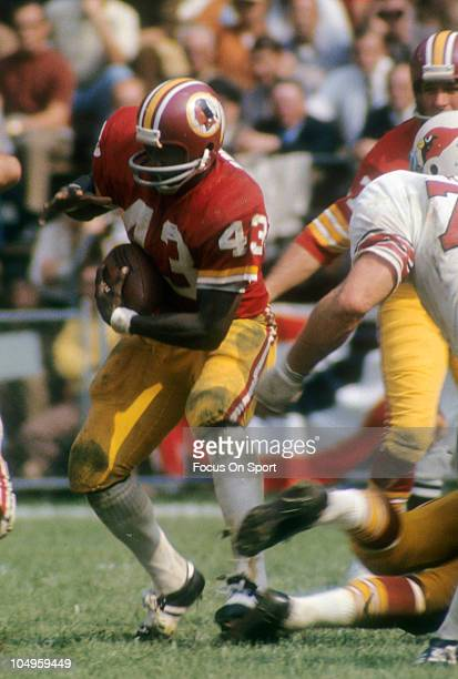 Running back Larry Brown of the Washington Redskins carries the ball against the St Louis Cardinals during an NFL game circa 1973 at RFK Stadium in...