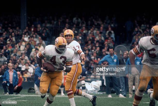 Running back Larry Brown of the Washington Redskins carries the ball against the New York Giants during an NFL football game circa 1970 at Yankee...