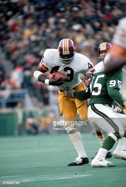 Running back Larry Brown of the Washington Redskins carries the ball against the Philadelphia Eagles during an NFL football game circa 1972 at...