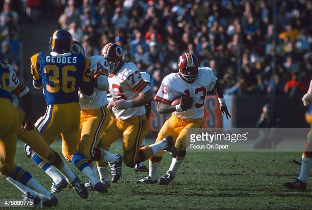 Running back Larry Brown of the Washington Redskins carries the ball against the Los Angeles Rams during an NFL football game circa 1974 at the Los...