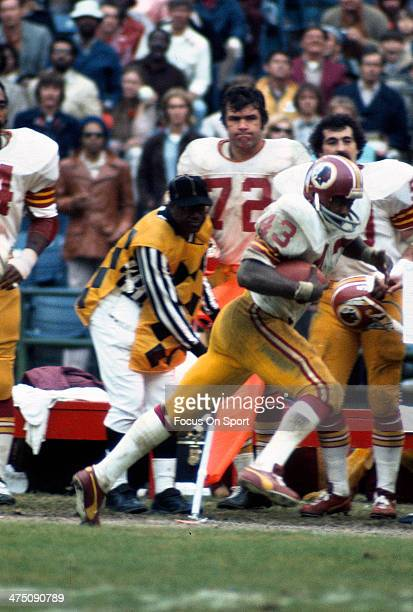 Running back Larry Brown of the Washington Redskins carries the ball during an NFL football game circa 1972 Brown played for the Redskins from 196976