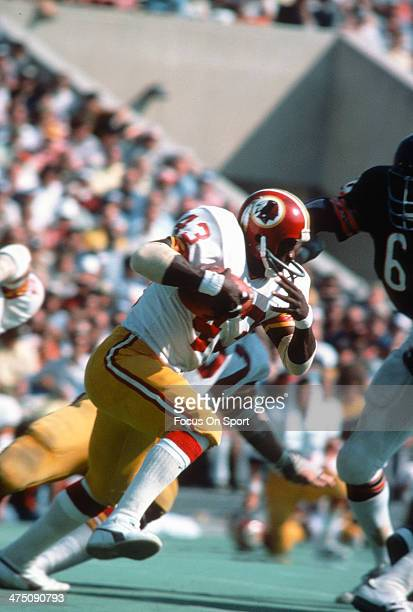 Running back Larry Brown of the Washington Redskins carries the ball against the Chicago Bears during an NFL football game October 3 1976 at Soldier...
