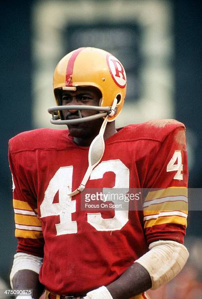 Running back Larry Brown of the Washington Redskins looks on against the Dallas Cowboys during an NFL football game circa 1970 at RFK Stadium in...