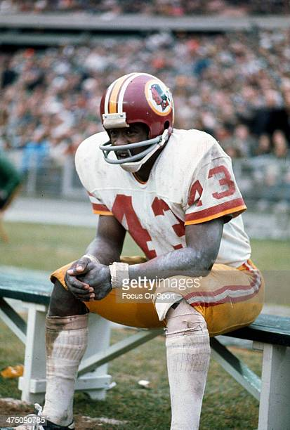 Running back Larry Brown of the Washington Redskins looks on from the bench during an NFL football game circa 1972 Brown played for the Redskins from...