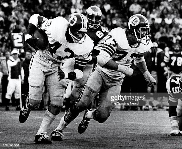 Running back Larry Brown of the Washington Redskins runs behind the block of Paul Laaveg against the Philadelphia Eagles circa 1974 Brown played for...