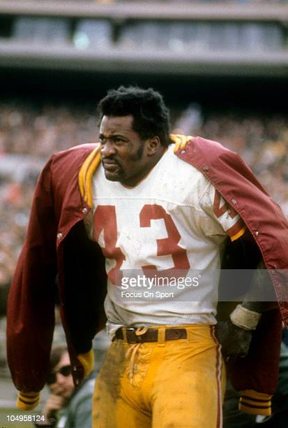 Running back Larry Brown of the Washington Redskins watching the action from the sidelines against the New York Jets during an NFL game November...