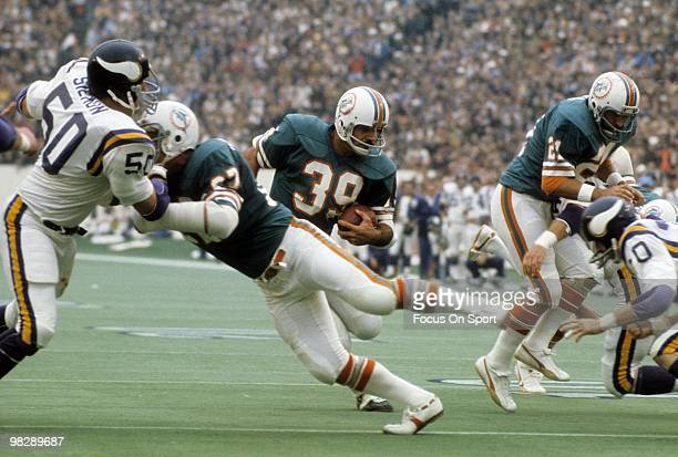 Running back Larry Csonka of the Miami Dolphins carries the ball against the Minnesota Vikings January 13 1974 during Super Bowl VIII at Rice Stadium...