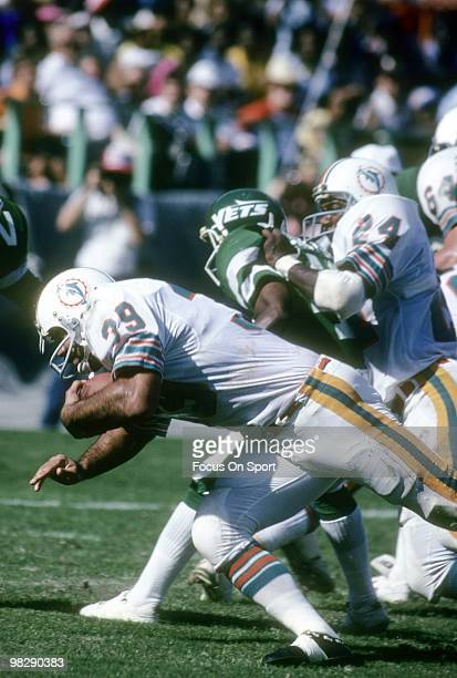 Running back Larry Csonka of the Miami Dolphins in action carries the ball against the New York Jets December 15 1979 during an NFL football game at...