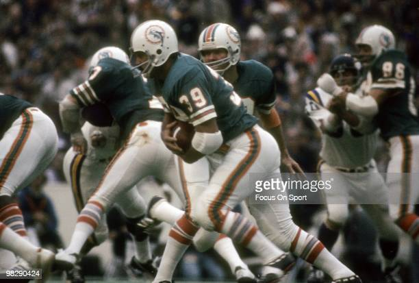 Running back Larry Csonka of the Miami Dolphins takes the hand off from quarterback Bob Griese against the Minnesota Vikings January 13 1974 during...