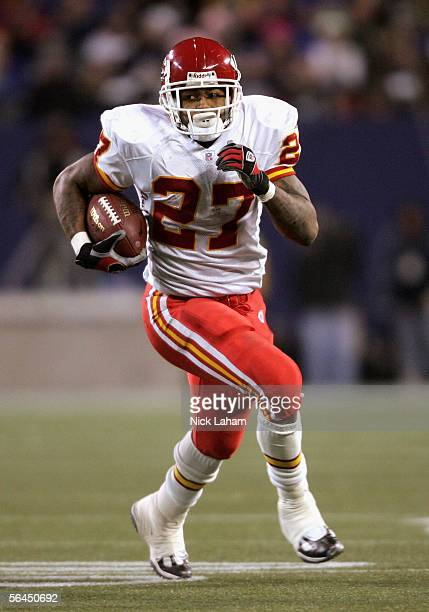 Running back Larry Johnson of the Kansas City Chiefs carries the ball in the second half of the game against the New York Giants at Giants Stadium on...