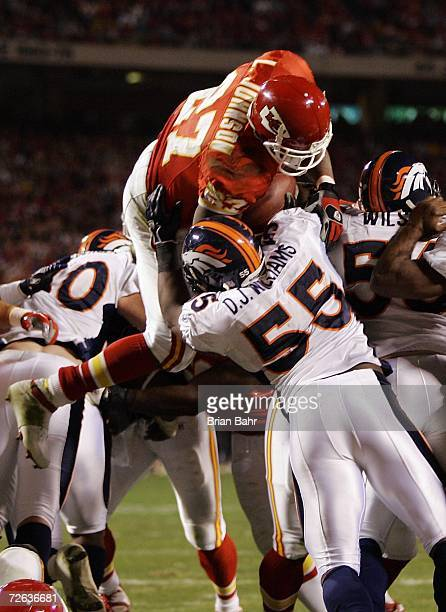 Running back Larry Johnson of the Kansas City Chiefs goes over the top for a touchdown against the Denver Broncos in the second quarter on November...