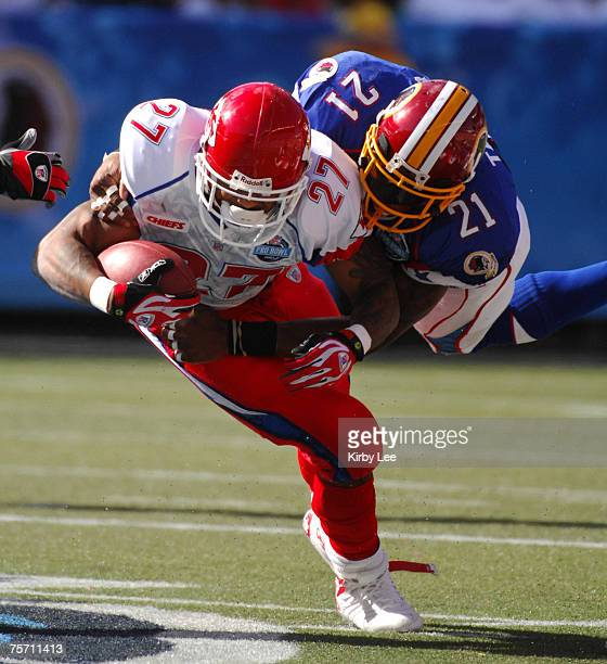 AFC running back Larry Johnson of the Kansas City Chiefs is tackled by NFC safety Sean Taylor of the Washington Redskins in the NFL Pro Bowl at Aloha...