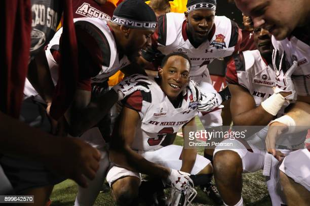 Running back Larry Rose III of the New Mexico State Aggies celebrates with teammates after scoring the game winning touchdown in overtime of the Nova...