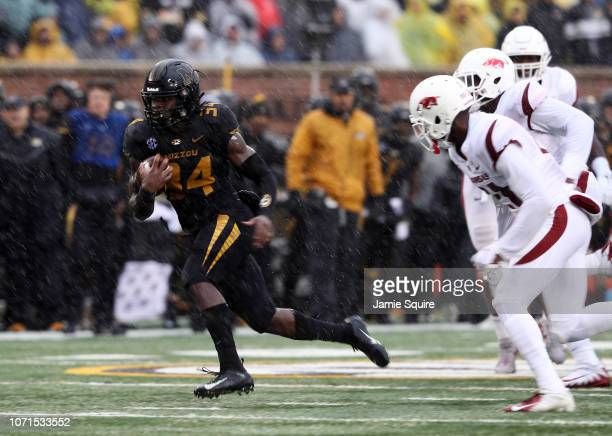 Running back Larry Rountree III of the Missouri Tigers carries the ball during the game against the Arkansas Razorbacks at Faurot Field/Memorial...