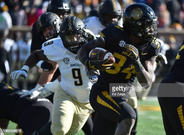 Running back Larry Rountree III of the Missouri Tigers rushes against Caleb Peart of the Vanderbilt Commodores in the fourth quarter at Memorial...