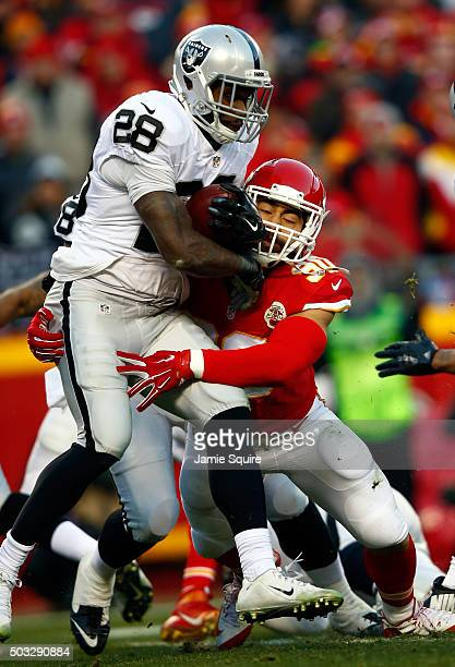Running back Latavius Murray of the Oakland Raiders carries the ball as inside linebacker Josh Mauga of the Kansas City Chiefs defends during the...
